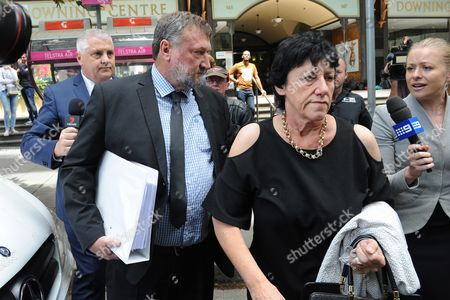 Greg (2-l) and Virginia Hughes (2-r) Parents of Cricketer Phillip Hughes Leave the Downing Centre Court in Sydney Australia 14 October 2016 the Family of Phillip Hughes Has Left a Coroner's Court During the Closing Submissions For a Five-day Inquest Into His Death in November 2014 After He was Struck on the Side of the Head by a Short-pitched Delivery From Friend and Pace Bowler Sean Abbott During a Sheffield Shield Match Australia Sydney