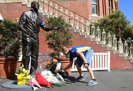 A Courier Driver Places Flowers at a Floral Tribute at the Feet of a Bronze Statue of Australian Test Cricketer and Broadcaster Richie Benaud at the Sydney Cricket Ground in Sydney Australia 10 April 2015 Benaud who Played 64 Test Matches For Australia Between 1952 and 1964 Has Passed Away Aged 84 Australia Sydney