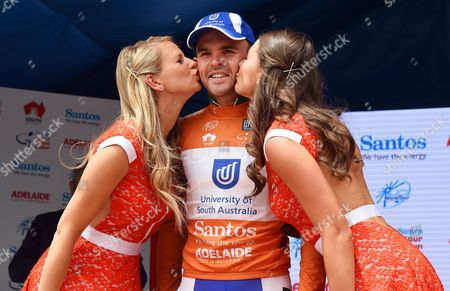 Australian Rider Jack Bobridge (c) of Team Uni Sa Wears the Overall Leader's Ochre Jersey As He is Kissed by Two Hostesses on the Podium After Winning the First Stage of the Tour Down Under Cycling Race in the Adelaide Hills Australia 20 January 2015 Australia Adelaide