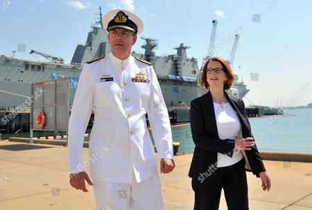 Australian Prime Minister Julia Gillard (r) and Chief of the Navy Ray Griggs Chat As They Walk Past the Hmas Canberra at Bae Systems Williamstown Shipyard in Williamstown in Melbourne Australia 15 February 2013 Dignataries Gathered 15 February For the Official Naming Ceremony of the Ship Which is Set to Be the Largest Ever in the Australian Naval Fleet Australia Melbourne