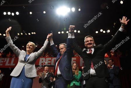 (l-r) Australia's Deputy Leader of the Opposition Tanya Plibersek Leader of the Opposition Bill Shorten and Shadow Treasurer Chris Bowen Join Hands During the Australian Labour Party (alp) Campaign Launch at the Joan Sutherland Performing Arts Centre As Part of the 2016 Election Campaign in Penrith Sydney New South Wales Australia 19 June 2016 the Australian Federal Election Will Be Held on 02 July Australia Sydney