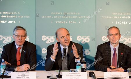 France's Minister of Finance Pierre Moscovici (c) Along with Bank of France Governor Christian Noyer (l) and General Director of Treasury Ramon Fernandez (r) Speak to the Media at a Press Conference During the G20 Finance Ministers and Central Bank Governors Meeting in Sydney New South Wales Australia 23 February 2014 Australia Sydney