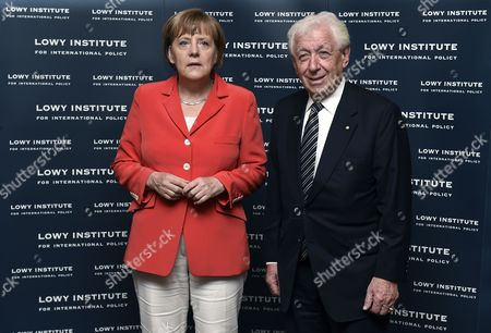 German Chancellor Angela Merkel (l) and Australian Businessman Frank Lowy Pose For a Photograph Before Delivering the Annual Lowy Lecture at the Lowy Institute in Sydney Australia 17 November 2014 Merkel is in Sydney Following Her Attendance at G20 Summit in Brisbane Australia Sydney