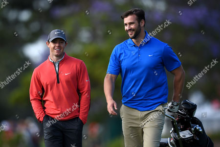 Northern Ireland's Rory Mcilroy (l) Talks with Television Personality Kris Smith (r on the Second Hole During the Pro-am For the Australian Open Golf Championship at the Australian Golf Club in Sydney Australia 26 November 2014 Australia Sydney