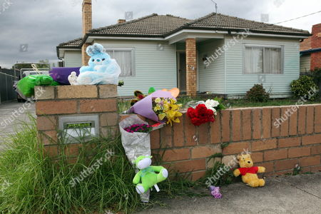 Stock Image of Toys and Flowers Are Left at the House in David Street Lalor in Melbourne Australia on 05 March 2010 From where Three-year-old Gurshan Singh Went Missing the Boy Went Missing From a House in Lalor on 04 March 2010 and His Body was Later Found Beside a Road in Oaklands Junction Deputy Police Commissioner Sir Ken Jones Said Police Were Treating the Incident As a Homicide and That He Had Assured India That Police Would Do Everything Possible to Find out what Happened Australia Melbourne
