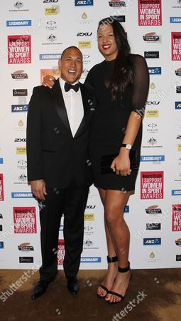 Australian Butterfly Swimmer Geoff Huegill and Australian Female Professional Basketball Player Liz Cambage on the Red Carpet of the 'I Support Women in Sport' Awards in Sydney Australia 15 October 2013 Australia Sydney