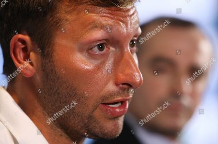 Olympic Gold Medalist Ian Thorpe (l) Watched by John Borghetti Ceo of Sponsor Virgin Blue Group of Airlines Announces His Comeback to Competitive Swimming During a Press Conference in Sydney Australia 02 November 2011 Thorpe 28 Announced on 02 November He Will Return to International Competitive Swimming in a Bid to Contest the London Olympics After Retiring From the Sport in 2006 Australia Sydney