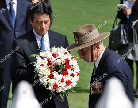 Japan's Foreign Minister Katsuya Okada Lays a Wreath at the Wa State War Memorial in Kings Park with Foreign Minister Stephen Smith and Colin Barnett Perth Australia on 21 February 2010 Okada is Meeting Mr Smith to Discuss Issues Including Whaling the Trilateral Relationship with the Us Free Trade and Regional Security Australia Perth