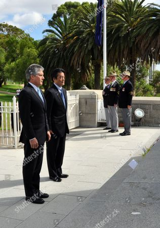 Japan's Foreign Minister Katsuya Okada (2-l) Lays a Wreath at the Wa State War Memorial in Kings Park with Foreign Minister Stephen Smith (l) and Colin Barnett (not Pictured) Perth Australia on 21 February 2010 Okada is Meeting Mr Smith to Discuss Issues Including Whaling the Trilateral Relationship with the Us Free Trade and Regional Security Australia Perth
