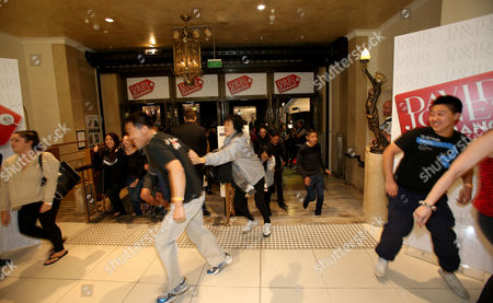 Shoppers Burst Through the Door at 5 Am After Waiting For Hours Outside For the Launch of the David Jones Clearance in the Elizabeth Street Store in the Central Business District Cbd Sydney Boxing Day 26 December 2012 Australia Sydney
