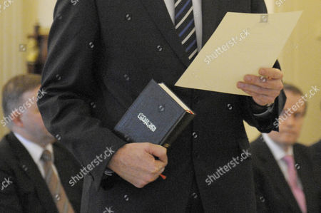 Stock Image of A Photograph Made Available on 02 July 2013 Showing Australian Minister For Immigration Tony Burke Holding a Holy Koran in His Hands As He is Sworn in by Governor General Quentin Bryce (not Pictured) at Government House in Canberra Australia 01 July 2013 Australian Labor Member of Parliament Ed Husic the First Muslim Elected to Federal Politics in Australia Has Defended Swearing His Oath As Parliamentary Secretary on the Koran Australia Canberra