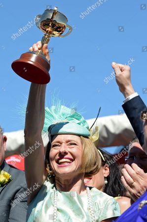 Trainer Gai Waterhouse Holds Up the Trainer's Cup After Her Horse Fiorente Ridden by Jockey Damien Oliver Won the Melbourne Cup at Flemington Racecourse in Melbourne Australia 05 November 2013 Australia Melbourne