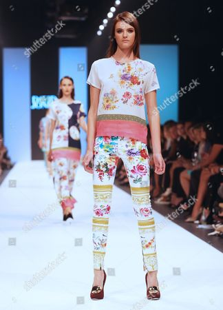 A Model Wears a Creation by Australian Design Duo Anna Plunkett and Luke Sales Label 'Romance was Born' During the L'oreal Melbourne Fashion Festival Opening Event in Melbourne Australia 19 March 2013 the Melbourne Fashion Festival Runs From 18-24 March Australia Melbourne