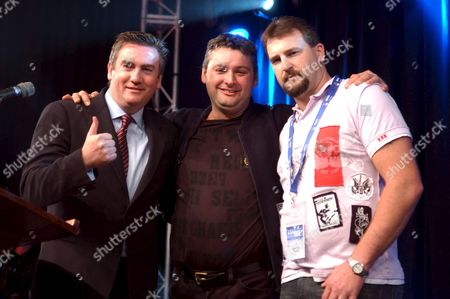 Stock Photo of Rescued Miners Todd Russell (r) and Brant Webb (c) who Were Trapped Underground at the Beaconsfield Mine For 14 Days on Stage with Channel 9 Ceo Eddie Mcguire at the Beaconsfield Community Hall Thursday May 11 2006 For the Beaconsfield Bash Fund Raising Event the Event Aired on the Nine Network's Afl and Nrl Footy Shows Australia Beaconsfield