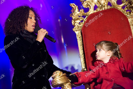 Stock Picture of Singers Rissi Palmer (left) and Kaitlyn Maher, age 4, perform at the lighting of the National Christmas Tree at the White House