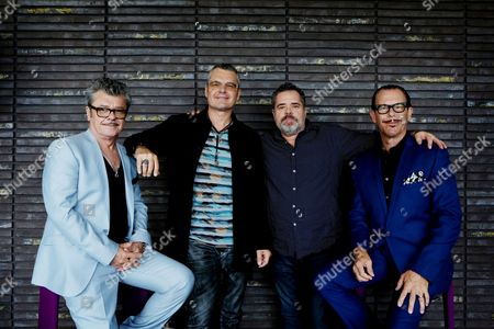 Stock Picture of Members of Australian Band Inxs (l-r) Tim Farriss Jon Farriss Andrew Farriss and Kirk Pengilly Pose During a Photocall in Sydney Australia 05 December 2014 Following the Screening of the Tv Miniseries About Inxs 'Never Tear Us Apart' in Australia and New Zealand in 2014 the Band's Geatest Hits Album 'The Very Best' (2011) Charted Number One Again Australia Sydney