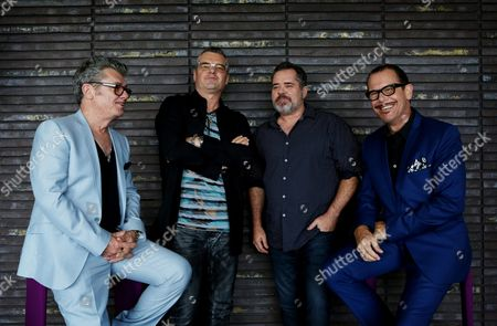 Members of Australian Band Inxs (l-r) Tim Farriss Jon Farriss Andrew Farriss and Kirk Pengilly Pose During a Photocall in Sydney Australia 05 December 2014 Following the Screening of the Tv Miniseries About Inxs 'Never Tear Us Apart' in Australia and New Zealand in 2014 the Band's Geatest Hits Album 'The Very Best' (2011) Charted Number One Again Australia Sydney