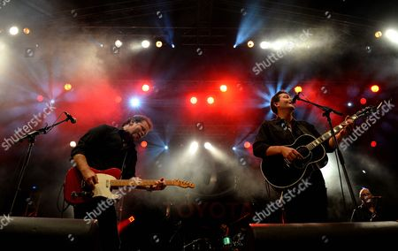 Stock Photo of Australian Country Music Singers Troy Cassar-daley (l) and Adam Harvey (r) Perform During the Opening Concert of the 42nd Tamworth Country Music Festival in Tamworth New South Wales Australia 17 January 2014 Th Festival Runs From 17 to 26 January Australia Tamworth