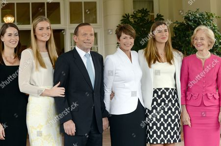 Australian Prime Minister Tony Abbott Poses with Governor General Quentin Bryce (r) and His Immediate Family Louise (l) Frances (2-l) Bridget and Wife Margie (2-r) on the Steps of Government House For a Photo Shoot After His Swearing in Ceremony in Canberra Australia 18 Sepember 2013 Australia Canberra