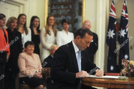 Tony Abbott (c) is Sworn in As Australia's Prime Minister by Governor-general Quentin Bryce (not in the Picture) As His Family Iis Looking on During the Ceremony at Government House in Canberra Australia 18 Sepember 2013 Australia Canberra