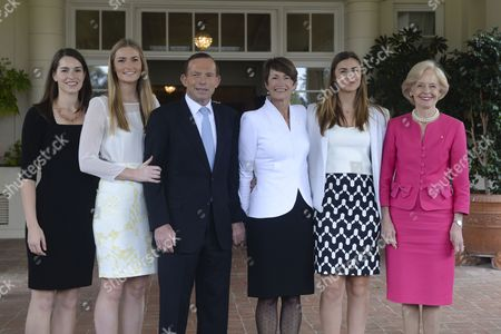 Australian Prime Minister Tony Abbott (3-l) Poses with Governor General Quentin Bryce (r) and His Immediate Family Louise (l) Frances (2-l) Bridget (2-r) and Wife Margie (3-r) on the Steps of Government House For a Photo Shoot After His Swearing in Ceremony in Canberra Australia 18 Sepember 2013 Australia Canberra