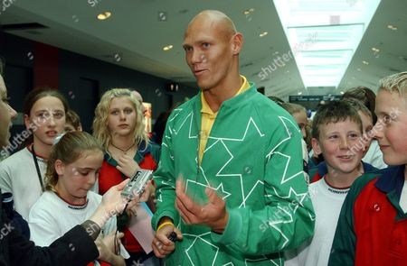Australian Olympic Swimmer Michael Klim Talks to a Member of the Media on Arrival at Melbourne Airport Melbourne 01 September 2004 Michael and Other Members From the Australian Olympic Team Returned Today From a Successful Campaign at the Athens Olympic Games Australia Melbourne