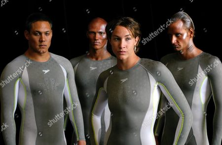 Australian Swimmers (l-r) Geoff Huegill Michael Klim Elka Graham and Italy's Olympic Gold Medalist Massi Rosolino Pose For the Photographers in the New Speedo Fastskin Fsii Following It's Launch in Sydney Tuesday 09 March 2004 the Swimwear Company Said the New Full Fastskin Fsii Bodyskin Had Different Fabrics For Different Parts of the Body and Would Be Stroke Specific For Each Swimmer the Entire Australian Olympic Shadow Squad Will Be Fitted with the Suit in Time For the Olympic Trials in Sydney Australia Sydney