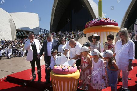Members of the Official Party Including Australian Singer Jimmy Barnes (l) Chairman of the Opera House Trust John Symond (2-l) Chef Matt Moran (c) New South Wales Governor General Professor Marie Bashir (3-r) and the Family of Sydney Opera House Architect Joern Utzon Enjoying the Festivities at the 40th Anniversary of the Sydney Opera House in Sydney Australia 20 October 2013 Australia Sydney