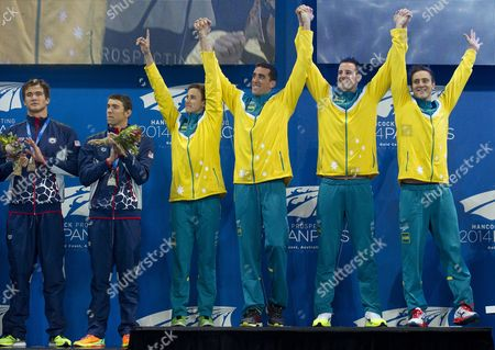 Australian Swimmers L to R; Cameron Mcevoy Matt Abood James Magnussen and Tommaso D'orsogna Celebrate During Their Medal Presentation After Winning the Mens 4 X 100m Freestyle at the Pan Pacific Swimming Championships at the Gold Coast Aquatic Centre on the Gold Coast Australia 22 August 2014 Australia Gold Coast
