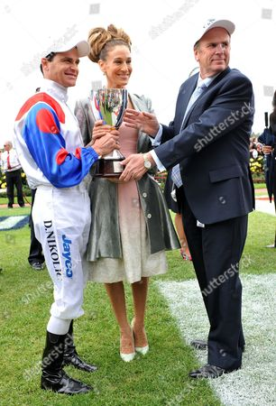 Stock Photo of From L-r Jockey Danny Nikolic Us Actress Sarah Jessica Parker and Trainer Robert Smerdon Pose For Photos After Mosheen Won the Oaks at Flemington Racecourse in Melbourne Australia 03 November 2011 Oaks Day is the Traditional Ladies Day of the Melbourne Cup Carnival Australia Melbourne