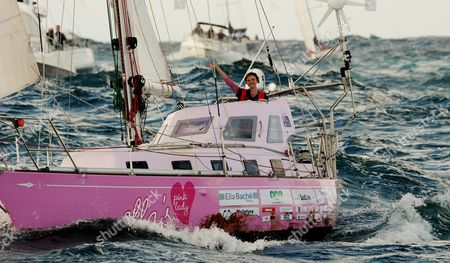 Teen Sailor Jessica Watson Waves As She Sails Into Sydney Harbour Aboard Her Yacht Ella's Pink Lady Australia 15 May 2010 Watson 16 Became the Youngest Person to Sail Solo Unassisted and Non-stop Around the World After Crossing 23 000 Nautical Miles (about 38 000km) in 210 Days Australia Sydney