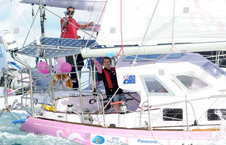 Teen Sailor Jessica Watson (r) Sails Into Sydney Harbour Aboard Her Yacht Ella's Pink Lady Australia 15 May 2010 Watson 16 Became the Youngest Person to Sail Solo Unassisted and Non-stop Around the World After Crossing 23 000 Nautical Miles (about 38 000km) in 210 Days Australia Sydney