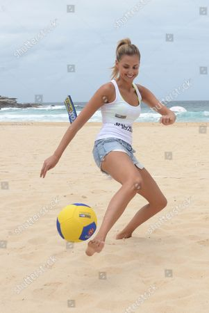 Former Miss Universe Entrant and Now Television Personality Laura Dundovic Kicks a Soccer Ball Around During the Launch of the A-league Summer Football Campaign at Maroubra Beach Sydney Australia 17 December 2012 Over the 12 Days of Christmas A-league Teams Will Play Fifteen Soccer Matches Australia Sydney