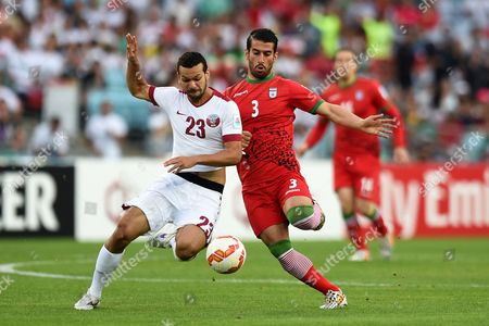 Qatar's Ahmed El Sayed (l) in Action Against Ehsan Hajsafi (r) of Iran During the Afc Asian Cup Group C Soccer Match Between Qatar and Iran at Stadium Australia in Sydney Australia 15 January 2015 Australia Sydney
