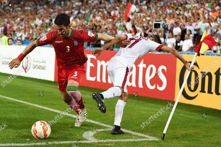 Iran's Ehsan Hajsafi (l) in Action Against Hasan Al Haydos (r) of Qatar During the Afc Asian Cup Group C Soccer Match Between Qatar and Iran at Stadium Australia in Sydney Australia 15 January 2015 Australia Sydney
