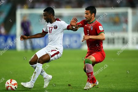 Qatar's Ismail Mohamad (l) in Action Against Ehsan Hajsafi (r) of Iran During the Afc Asian Cup Group C Soccer Match Between Qatar and Iran at Stadium Australia in Sydney Australia 15 January 2015 Australia Sydney