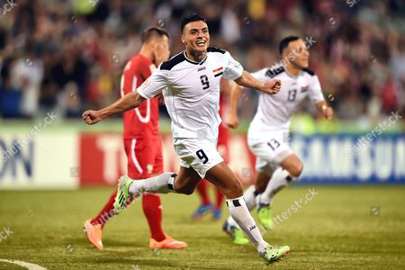 Iraq's Ahmed Yaseen Ghani (c) Celebrates After Scoring the 2-0 Goal During the Afc Asian Cup Group D Soccer Match Between Iraq and Palestine in Canberra Australia 20 January 2015 Epa/paul Miller Australia Canberra