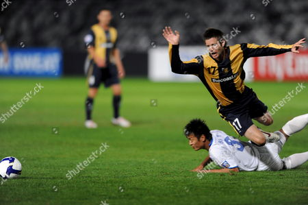 Central Coast Mariners Pedj Bojic (right) Takes Control of the Ball Despite Pressure From Tian Yuan of the Chinese Team Tianjin Teda During Their Afc Champions League Match in Gosford Australia 19 May 2009 Tianjin Won the Match 1-0 Australia Gosford