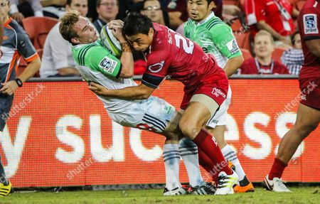 Ayumu Goromaru of the Reds Tackles Hayden Parker (l) of the Highlanders During the Round 7 Super Rugby Match Between the Queensland Reds and the Highlanders at Suncorp Stadium in Brisbane Australia 09 April 2016 Australia Brisbane