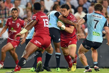Ayumu Goromaru of the Reds is Tackled by Kurtley Beale of the Waratahs During the Super Rugby Match Between Australian Teams Nsw Waratahs and Queensland Reds at Allianz Stadium in Sydney Australia 27 February 2016 Australia Sydney