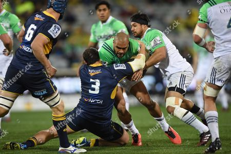 Ruan Smith of the Brumbies (c-l) Tackles Patrick Osborne of the Highlanders During the Quarter Final Super Rugby Match Between the Act Brumbies and the Highlanders at Gio Stadium in Canberra Australia 22 July 2016 Australia Canberra
