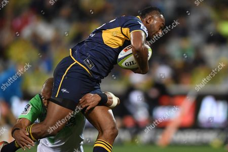Tevita Kuridrani (r) of the Brumbies is Tackled by Patrick Osborne of the Highlanders During the Quarter Final Super Rugby Match Between the Act Brumbies and the Highlanders at Gio Stadium in Canberra Australia 22 July 2016 Australia Canberra