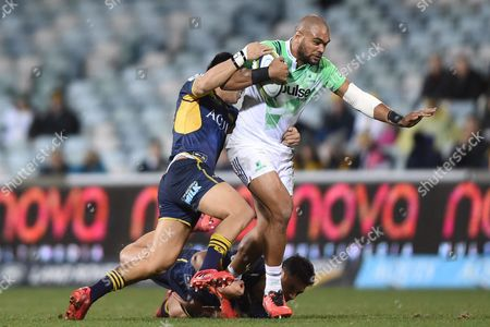 Christian Leali'ifano (l) and Matt Toomua of the Brumbies Tackle Patrick Osborne (c) of the Highlanders During the Quarter Final Super Rugby Match Between the Act Brumbies and the Highlanders at Gio Stadium in Canberra Friday July 22 2016 Australia Canberra