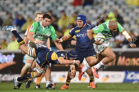 Patrick Osborne (r) of the Highlanders Steps Through a Tackle by Michael Wells of the Brumbies During the Quarter Final Super Rugby Match Between the Act Brumbies and the Highlanders at Gio Stadium in Canberra Friday July 22 2016 Australia Canberra
