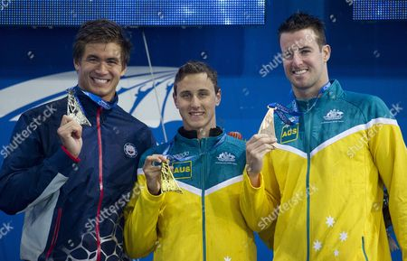 L to R; Nathan Adrian (usa) Australia's Cameron Mcevoy and James Magnussen Pose with Their Medals Following the Mens 100m Freestyle Final During Their Medal Ceremony Following the Mens 4 X 200m Freestyle Relay Final During the Pan Pacific Championships at the Gold Coast Aquatic Centre on the Gold Coast Friday August 22 2014 Australia Gold Coast