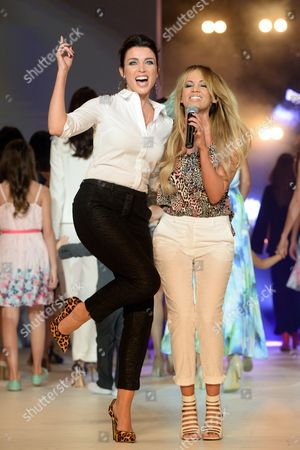 Australian Singer Dannii Minogue (l) Dances with Australian Singer and Actress Samantha Jade (r) Following Her Fashion Label Launch For Target Australia at the Mercedes Benz Fashion Festival in Sydney Australia 27 September 2014 Australia Sydney