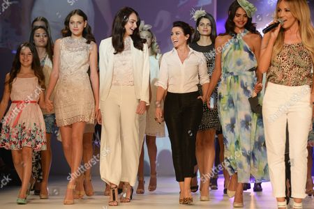 Australian Singer Dannii Minogue (4-r) Accompanies Models Wearing Her Creations As They Parade on the Runway Following Her Fashion Label Launch For Target Australia at the Mercedes Benz Fashion Festival in Sydney Australia 27 September 2014 on Far Right is Australian Singer and Actress Samantha Jade Australia Sydney