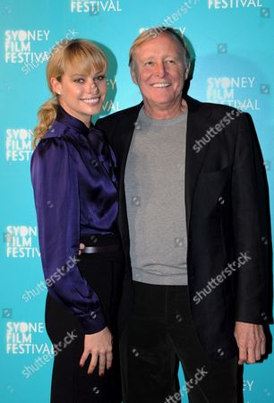 Stock Image of Australian Model Kristy Hinze (l) and Her Us Billionaire Husband Jim Clark at 'The Cove' Premiere During the Sydney Film Festival in Sydney Australia on 06 June 2009 the 56th Sydney Film Festival Runs From 03 - 14 June 2009 Australia Sydney