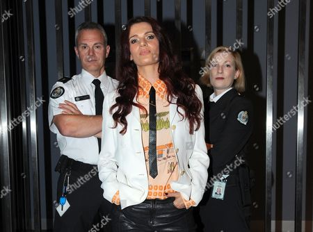 New Zealand Actress Danielle Cormack (c) Poses For Photographs with Two Models at a Special Screening of Foxtel's Soho Channel Presentation of Wentworth in Melbourne Australia 23 April 2013 Australia Melbourne