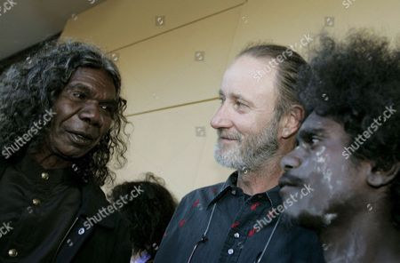 David Gulpilil (l) Talks to the Media About His Son Jamie Gulpilil (r) Along with Filmmaker Rolf De Heer (c) at the Film Premiere of Ten Canoes at Her Majesty's Theatre in Adelaide As Part of the Adelaide Film Festival Sunday 19 March 2006 Australia Adelaide